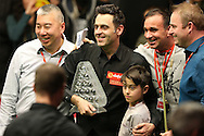 Ronnie O'Sullivan (Eng) poses with his manager and family as he  lifts the Paul Hunter Masters Trophy after defeating Joe Perry (Eng) .Ronnie O'Sullivan (Eng) v Joe Perry (Eng), the Masters Final at the Dafabet Masters Snooker 2017, at Alexandra Palace in London on Sunday 22nd January 2017.<br /> pic by John Patrick Fletcher, Andrew Orchard sports photography.