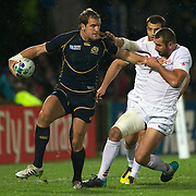 Rory Lamont, Scotland, (left) is tackled by Tedo Zibzbadze, Georgia, during the Scotland V Georgia Pool B match  during the IRB Rugby World Cup tournament.  Invercargill, New Zealand, 14th September 2011. Photo Tim Clayton....