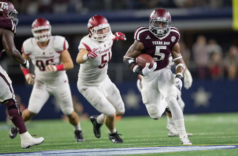 Texas A&M's running back Trayveon Williams (5) breaks free for a touchdown against Arkansas during the fourth quarter of an NCAA college football game Saturday, Sept. 24, 2016, in Arlington, Texas. (The Eagle/Sam Craft)