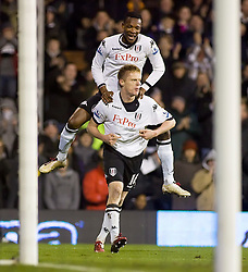 02.02.2011, Craven Cottage, London, ENG, PL, Fulham FC vs Newcastle United, im Bild Fulham's John Paintsil climbs on Fulham's Damien Duff  after he scores Fulham's opener //  during the Premiership match against Fulham FC vs Newcastle United at Graven Cottage, EXPA Pictures © 2011, PhotoCredit: EXPA/ IPS/ M. Greenwood *** ATTENTION *** UK AND FRANCE OUT!