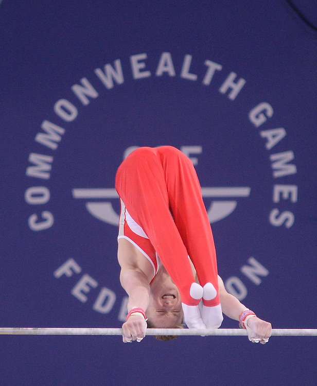 England's Nile Wilson during his performance on the horizontal bar during the men's all-round final<br /> <br /> Photographer Chris Vaughan/CameraSport<br /> <br /> 20th Commonwealth Games - Day 7 - Wednesday 30th July 2014 - Gymnastics - The SSE Hydro - Glasgow - UK<br /> <br /> © CameraSport - 43 Linden Ave. Countesthorpe. Leicester. England. LE8 5PG - Tel: +44 (0) 116 277 4147 - admin@camerasport.com - www.camerasport.com