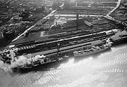 "ackroyd-04292-7. ""April 1, 1953"" Union Station, UP rail yards, Lovejoy Viaduct, Broadway Bridge & NW Portland looking west."