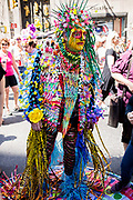New York, NY - April 16, 2017. A man covered a thousands of tiny bits of colorful things at New York's annual Easter Bonnet Parade and Festival on Fifth Avenue.