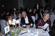 Martin Summers and Mrs. Arnaud Bamberger. Conde Nast Traveller Tsunami Appeal dinner. Four Seasons  Hotel. Hamilton Place, London W1. 2 March 2005. ONE TIME USE ONLY - DO NOT ARCHIVE  © Copyright Photograph by Dafydd Jones 66 Stockwell Park Rd. London SW9 0DA Tel 020 7733 0108 www.dafjones.com