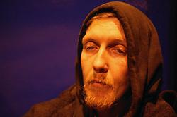 Homeless man sleeping rough in the inner city streets,