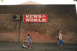 © Licensed to London News Pictures. 26/06/2014. London, UK. A sign advertising the defunct newspaper  News of the World still stands outside a shop in east London. This week, former News of the World executive Rebekah Brooks was acquitted of phone hacking while former editor Andy Coulson was found guilty of conspiring to hack phones. Photo credit : LNP