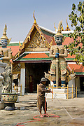Man cleans inside The Grand Palace and Temple Complex, Bangkok, Thailand