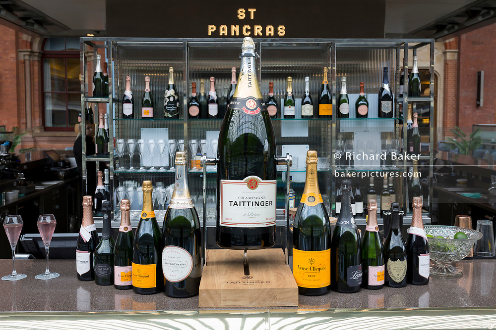 As the UK government urged that all Britons should avoid non-essential travel abroad in order to combat the Coronavirus pandemic in Britain, a Champagne bar offering jeroboams and magnums of Champagne remains without customers on an empty upper concourse at St. Pancras rail station, the London terminus for Eurostar services to mainland Europe, on 17th March 2020, in London, England.