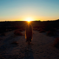 """Sacred Woman Sun Gazing on a desert summer morning. 