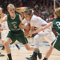 Shiprock Chieftain Tanisha Begay (23) protects the ball from Hope Christian  Huskies Charity Murphy (5) and Christine Heisey (23) at the State 4a championship game in Albuquerque Friday.