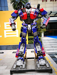 August 27, 2017 - Yichang, Yichang, China - Yichang, CHINA-27th August 2017: (EDITORIAL USE ONLY. CHINA OUT) ..Two giant statues of transformers promote real estate sales in Yichang,central China's Hubei Province, August 27th, 2017. (Credit Image: © SIPA Asia via ZUMA Wire)