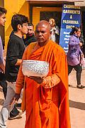 Buddhist monk Boudhanath stupa in Kathmandu, Nepal