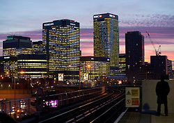 © Licensed to London News Pictures. 04/02/2016. London, UK. A sunset view of business district Canary Wharf, Tower Hamlets, from East India DLR station in east London. Photo credit : Isabel Infantes / LNP