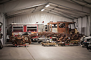 One of the  fire trucks that are part of a collection of artifacts saved from the site of the World Trade Center after 9/11. Artifacts chosen by curators out of the wreckage  from the World trade Center  stored temporarily within an 80,000 square foot hanger at JFK airport,Hanger 17 . Some of the artifacts will be in the National September 11 Memorial Museum set to open in 2012. within an 80,000 square foot hanger at JFK airport. Some of the artifacts will be in the National September 11 Memorial Museum set to open in 2012.
