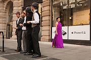 "A barbershop quartet sings ""Standing on the corner"" as lead dancer Jessica Grippo walks past."