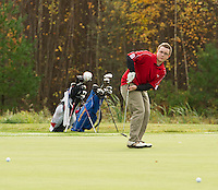 Laconia's Matthew Missert takes a putt on the 17th hole during the NHIAA Division III & IV State Championship tournament at Ridgewood Country Club in Moultonboro Thursday morning.  (Karen Bobotas/for the Laconia Daily Sun)