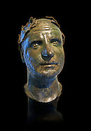 Bronze head of possibly Trebonianus Gallus, 251-253 A.D., inv 15032, Vatican Museum Rome, Italy, black background ..<br /> <br /> If you prefer to buy from our ALAMY STOCK LIBRARY page at https://www.alamy.com/portfolio/paul-williams-funkystock/greco-roman-sculptures.html . Type -    Vatican    - into LOWER SEARCH WITHIN GALLERY box - Refine search by adding a subject, place, background colour, museum etc.<br /> <br /> Visit our CLASSICAL WORLD HISTORIC SITES PHOTO COLLECTIONS for more photos to download or buy as wall art prints https://funkystock.photoshelter.com/gallery-collection/The-Romans-Art-Artefacts-Antiquities-Historic-Sites-Pictures-Images/C0000r2uLJJo9_s0c