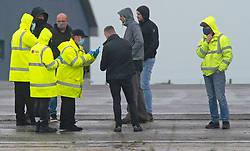 © Licensed to London News Pictures 23/12/2020.        Manston, UK. Medical staff at the airport helping a lorry driver register for a test. The Army and NHS staff have arrived at Manston Airport to administer Covid-19 lateral flow tests to truckers who are stranded in Kent. Angry lorry drivers blockading local roads and clashed with police in Kent this morning. France have closed its borders to all freight traffic because of the new Coronavirus strain. Photo credit:Grant Falvey/LNP