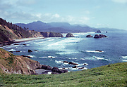 CS00971-05. Indian Beach, Cannon Beach, Haystack Rock and the Pacific Ocean seen from Clatsop Loop Trail in Ecola Park, looking south. ca. 1940