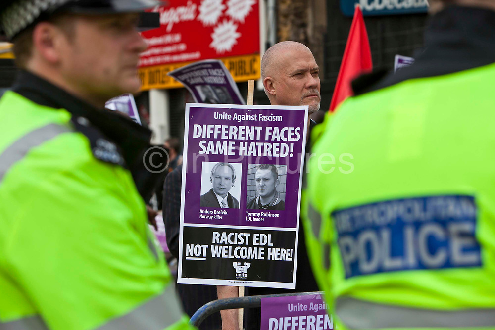 Unite Against Fascism demo against the EDL, 3rd September 2011.  Aldgate, East London.  Hundreds of antifascists, trade unionists and members of the local community gathered in Whitechapel after the English Defence League attempted to demonstrate in Tower Hamlets. Only around 600 members of EDL made it to their final rally point – at Aldgate, outside the Tower Hamlets borough boundary in East London.