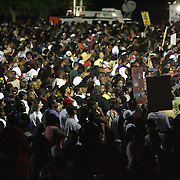 Crowds reaching in the thousands listen during a rally for the shooting of Trayvon Martin on Thursday, March 22, 2012 at Fort Mellon Park in Sanford, Florida. (AP Photo/Alex Menendez) Trayvon Martin rally in Sanford, Florida.