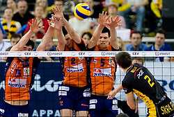 Mariusz Wlazly of Belchatow (R) vs Vid Jakopin, Alen Pajenk and Alen Sket  of ACH at  match for 3rd place of CEV Indesit Champions League FINAL FOUR tournament between PGE Skra Belchatow, POL and ACH Volley Bled, SLO on May 2, 2010, at Arena Atlas, Lodz, Poland.  (Photo by Vid Ponikvar / Sportida)