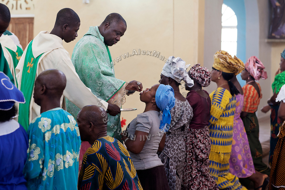 The Archbishop of Jos, Ignatius Kaigama, 54, is serving communion to devotees before celebrating a Mass Service at the Christian Catholic Cathedral Of Our Lady Fatima in Jos, Plateau State, Nigeria.