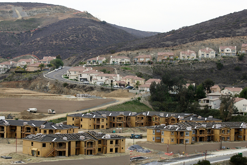 SAN DIEGO, CA- February 25, 2006:  Homes are sitting on the market longer as the nation's housing boom slows down in places like the once sizzling San Diego, California market. Even so new developments continue to dot the hillsides.