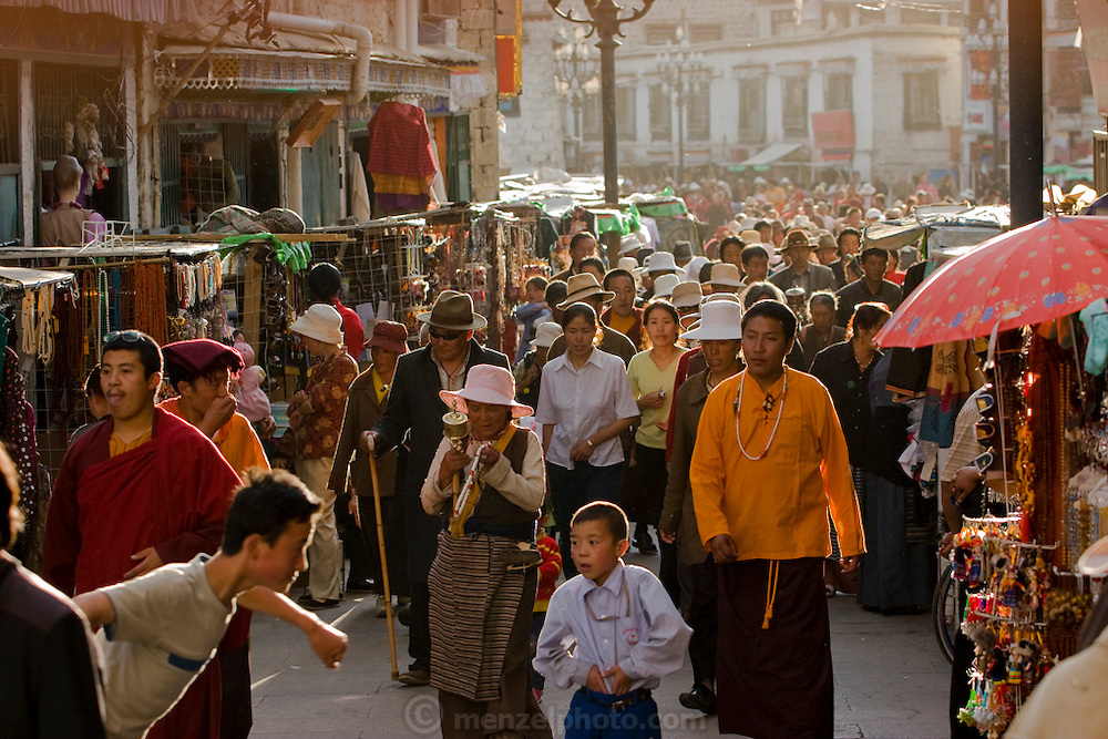 People walk on a busy street in Lhasa, Tibet.