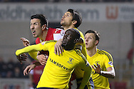 Rotherham United defender Richard Wood (6) , Middlesbrough defender George Friend (3)  nd Middlesbrough midfielder Albert Adomah (27) all wait for the ball during the Sky Bet Championship match between Rotherham United and Middlesbrough at the New York Stadium, Rotherham, England on 8 March 2016. Photo by Simon Davies.