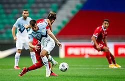 Damjan Bohar of Slovenia vs Catalin Carp of Moldova during the UEFA Nations League C Group 3 match between Slovenia and Moldova at Stadion Stozice, on September 6th, 2020. Photo by Vid Ponikvar / Sportida