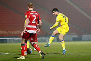 Ryan Longman of AFC Wimbledon  shoots during the EFL Sky Bet League 1 match between Doncaster Rovers and AFC Wimbledon at the Keepmoat Stadium, Doncaster, England on 26 January 2021.