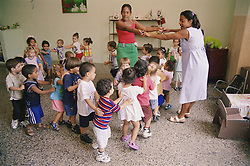 Nursery school children playing game in classroom,