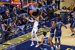 Dec 1, 2019; Morgantown, WV, USA; West Virginia Mountaineers forward Emmitt Matthews Jr. (11) shoots in the lane during the first half against the Rhode Island Rams at WVU Coliseum. Mandatory Credit: Ben Queen-USA TODAY Sports