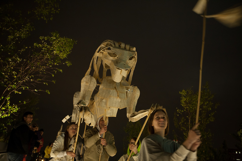 New York, NY - 30 April 2012. Two large, animated lions made of book-page papier-maché, with text still visible , were carried the length of the parade. The parade and its oversized puppetry was produced by The Processional Arts Workshop.