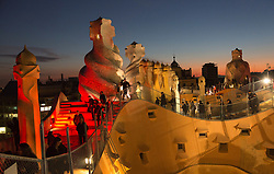 "© Licensed to London News Pictures. 1 December 2012. Barcelona, Spain. Show ""Emocions en moviment"" on the roof. In 1912, La Pedrera (Casa Mila), Barcelona's iconic landmark by architect Antoni Gaudi was finished  To celebrate 100 years of La Pedrera, Barcelona citizens were treated to a free tour of the building where 150 dancers and musicians performed around every corner and on the roof. Later, images were projected onto the façade of the building with live dancers interacting with them. Photo credit: Bettina Strenske/LNP"