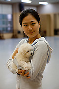 Portrait of a student for Modern Dance with her dog at Keimyung University  in Daegu. Daegu, also known as Taegu and officially the Daegu Metropolitan City, is the third largest metropolitan area in South Korea, and by city limits, the fourth largest city with over 2.5 million people. The IAAF World Championships in Athletics will take place in Daegu from the 27th of August till the 4th of September 2011.