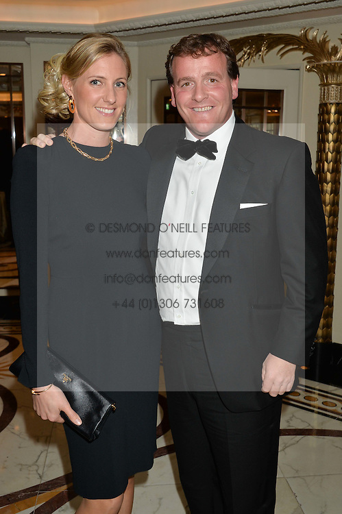RICHARD HANNON JNR and his wife JEMIMA at the 24th Cartier Racing Awards held at The Dorchester, Park Lane, London on 11th November 2014.