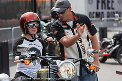 Jeanie Peaden gets last minute tips from Harley-Davidson's Randall Taylor before setting out on her free demo ride from the Harley-Davidson foot print at Daytona International Speedway during Daytona Bike Week's 75th Anniversary event. FL, USA. Saturday March 12, 2016.  Photography ©2016 Michael Lichter.