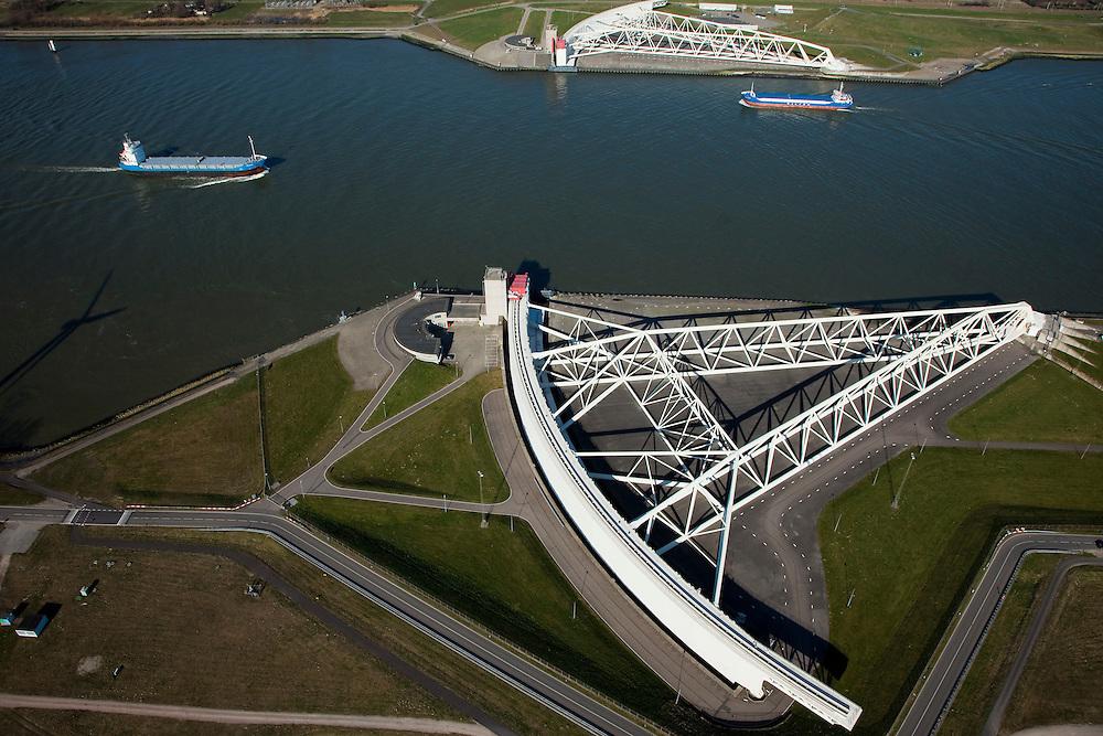 Nederland, Zuid-Holland, Rotterdam, 20-03-2009; Maeslantkering in de Nieuwe Waterweg, de waterkering sluit bij een waterstand van 3 meter of meer boven NAP; de kering, onderdeel van de Deltawerken, beschermt Rotterdam en het achterland bij extreme waterstanden.Netherlands, Hoek van Holland - Rotterdam harbour. Aerial view of the new storm surge barrier (Maeslantkering) in the Nieuwe waterweg, leading to the harbours. Two enormous doors will close of this river for high seas. .Swart collectie, luchtfoto (toeslag); Swart Collection, aerial photo (additional fee required).foto Siebe Swart / photo Siebe Swart