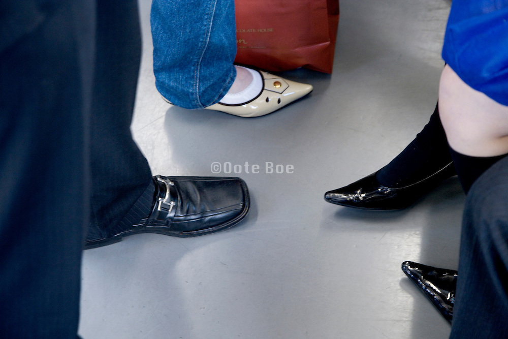 shoes of businessman and fashionable dressed women