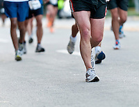 Close up of legs while running, use of selective focus, focus on shoes.