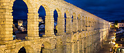 Famous spectacular Roman aqueduct at night, built of granite blocks, by Plaza del Azoguejo, Segovia, Spain