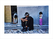Tito takes a siesta on the terrace of a relative's home. The Gitano barrio of Pescaderia where many Roma are crack addicts and dealers. Almeria, Spain Spring 2000...Roma Gypsies left Rajasthan in India a thousand years ago, in the ninth and tenth centuries. They were pushed west by the Ottoman Muslim Empire as it moved through Persia towards the frontiers of Europe. They entered Europe in the foutrteenth century and were slaves in Romania and Moldavia until the mid 1850s. There are about 15 million Roma gypries in the world, about 12 million who live in Europe. they are Europe's largest ethnic minority. They have rich traditions and culture, their own language. They are renowned for their prowess in music and dance; they are also skilled craftsman, metal roofmakers, silver and goldsmiths. Their traveling and nomadic lifestyle which grew from a necessity to find work, and because they were often moved on from one place to the next, has given them both a liberty but also marks them as different and they are often feared by sedentary peoples, who label and scapegoat them. They are hardy survivors and live in the brunt of racism and prejudice, often marginalised, living in poverty, without proper human rights afforded to them..