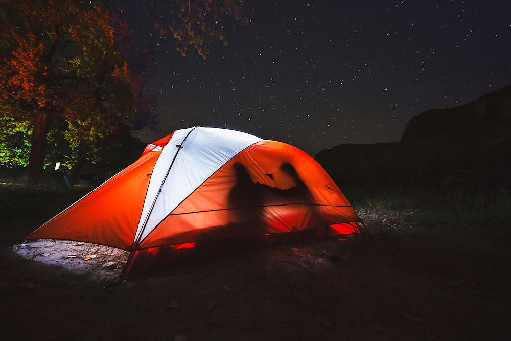 A glowing tent in the San Rafael Swell night.