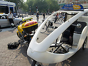 tram car motorcycle and tricycle taxi in Amsterdam on Leidse Plein