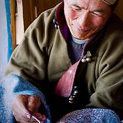 Mongolian horseman enjoys breakfast inside simple cabin (Khangil Nuur, Mongolia - Sep. 2008) (Image ID: 080915-0848411a)