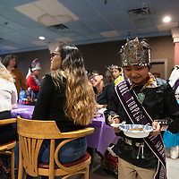 Joseph Roan, of Gallup, the Tobe Turpen Elementary Warrior serves stew to attendees at the New Mexico Indigenous Women's Resource Council launch celebration at Rio West Mall in Gallup Saturday.