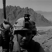 """Sep 11, 2009 - Golestan, Farah Province, Afghanistan - A US Marine from the 2nd MEB of the 2/3 Marines searches for insurgents on """"Fighting Mountain"""" aka """"Kohe Tengay"""" which in Pashto means """"Three Kings"""" after his unit was ambushed by insurgents near the Buji Bast Pass (aka Bhuji Bast)  in Golestan, Farah Province, where US Marines have been deadlocked in a bitter counterinsurgency campaign and conflict with insurgents using mainly Improvise Explosive Devices (IED's).<br /> (Credit Image: © Louie Palu/ZUMA Press)"""