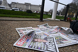 © Licensed to London News Pictures. 08/03/2021. London, UK. British newspapers placed on the floor outside Buckingham Palace in London following the release of an interview with Prince Harry, Duke of Sussex and his wife Meghan, Duchess of Sussex. The two hour event, hosted by Oprah Winfrey, aired in the early hours of the morning in the UK. Photo credit: Ben Cawthra/LNP
